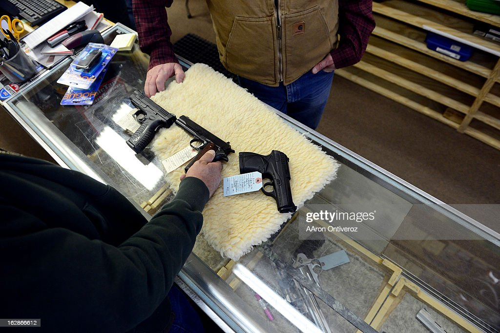 Andrew Gallegos buys a handgun from Valley Guns owner Carlton Thomas. Gun owners in southern Colorado largely agree that responsible ownership begins at home.