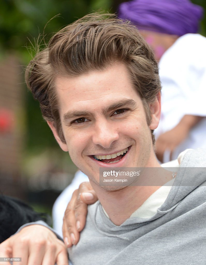 Andrew Garfield attends the 'Be Amazing' Stand Up Volunteer Initiative at Madison Boys And Girls Club on June 26, 2012 in the Brooklyn borough of New York City.