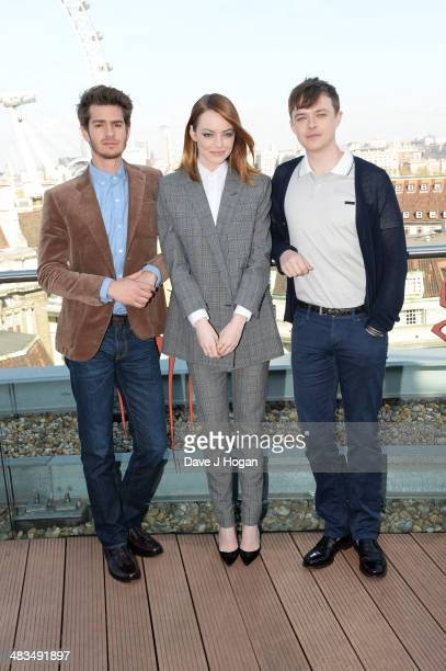 Andrew Garfield Emma Stone and Dane DeHaan pose at a photocall for 'The Amazing SpiderMan 2' at The Park Plaza Westminster Bridge Hotel on April 9...