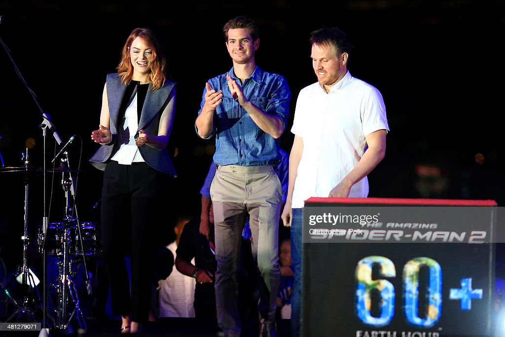 <a gi-track='captionPersonalityLinkClicked' href=/galleries/search?phrase=Andrew+Garfield&family=editorial&specificpeople=4047840 ng-click='$event.stopPropagation()'>Andrew Garfield</a>, <a gi-track='captionPersonalityLinkClicked' href=/galleries/search?phrase=Emma+Stone&family=editorial&specificpeople=672023 ng-click='$event.stopPropagation()'>Emma Stone</a> and Director <a gi-track='captionPersonalityLinkClicked' href=/galleries/search?phrase=Marc+Webb&family=editorial&specificpeople=637083 ng-click='$event.stopPropagation()'>Marc Webb</a> of 'The Amazing Spider-Man 2' attend the Earth Hour Kick-Off with Spider-Man, The First Super Hero Ambassador for Earth Hour, the global movement organized By WWF (World Wide Fund For Nature) on March 29, 2014 in Singapore. #spiderman