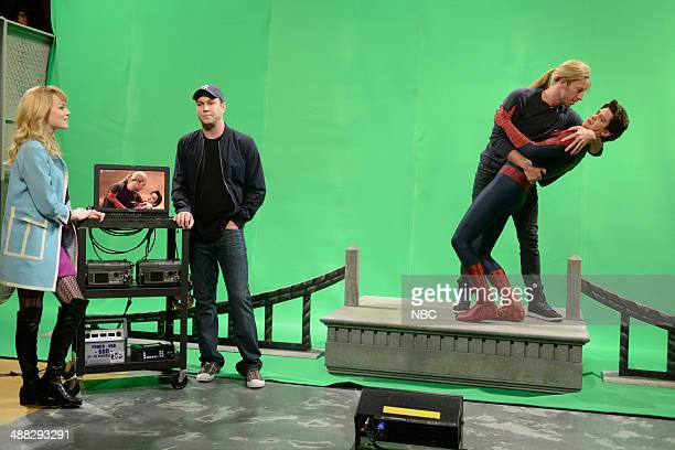 LIVE 'Andrew Garfield' Episode 1660 Pictured Emma Stone Taran Killam Chris Martin and Andrew Garfield during the 'Spiderman Kiss' skit on May 3 2014