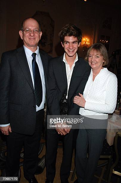 Andrew Garfield poses with his award for Best Newcomer with his parents at the Evening Standard Theatre Awards at the Savoy Hotel on November 27 2006...