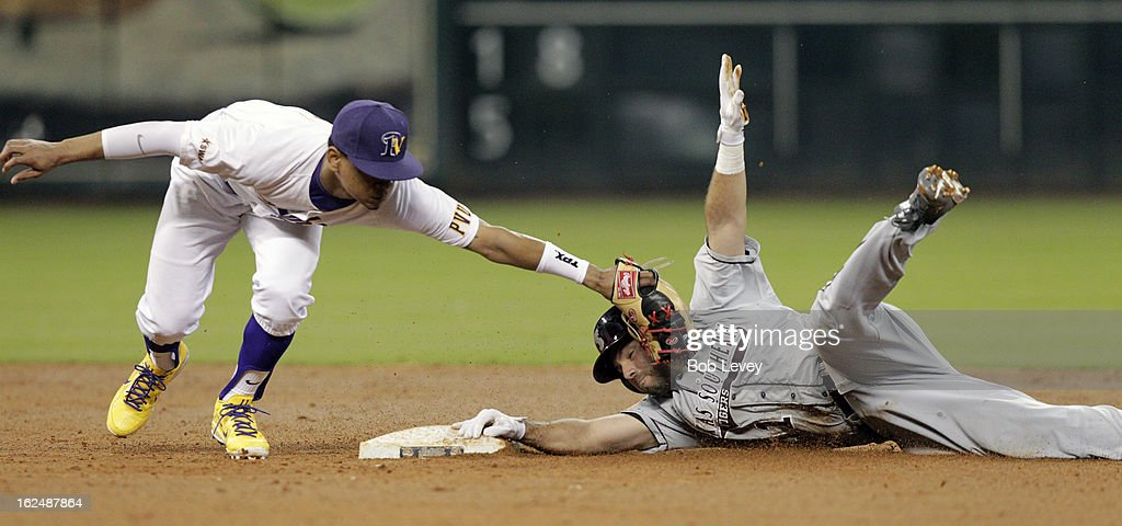 Andrew Garza #1 of TSU dives back into second base before Andre Oliver #11 of Prairie View A&M can apply the tag during the 2013 Urban Invitational, February 23, 2013 in Houston, Texas.