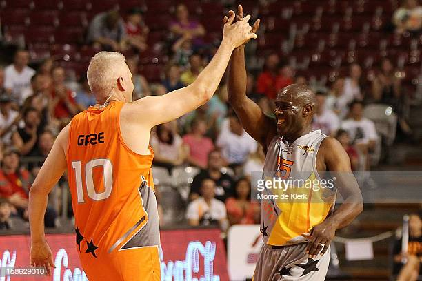 Andrew Gaze and Al Green congratulate each other after the Legends and Celebrities game that formed the half time entertainment during the NBL...