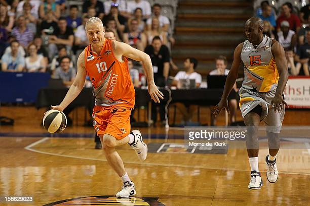 Andrew Gaze gets away with the ball in the Legends and Celebrities game that formed the half time entertainment during the NBL AllStar game between...