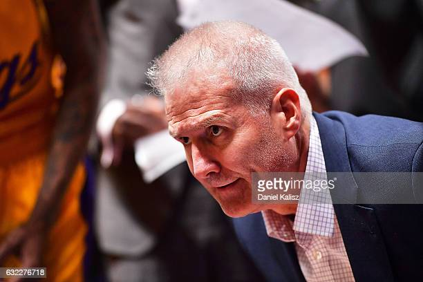 Andrew Gaze head coach of the Sydney Kings talks with his players during a time out perioud during the round 16 NBL match between the Adelaide 36ers...