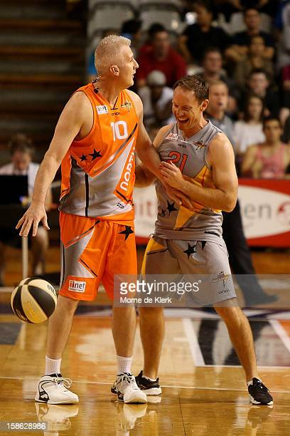 Andrew Gaze holds off Brenton Sanderson during the Legends and Celebrities game that formed the half time entertainment during the NBL AllStar game...