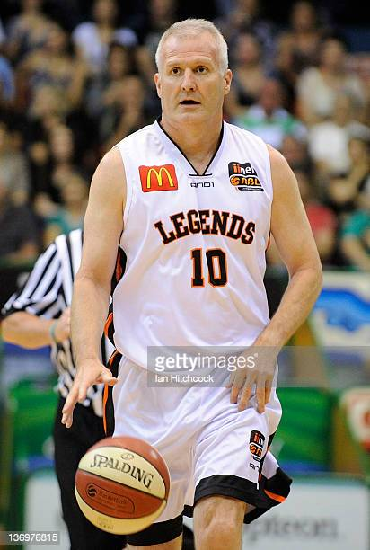 Andrew Gaze of the NBL Legends dribbles the ball during a legends match before the start of the round 15 NBL match between the Townsville Crocodiles...