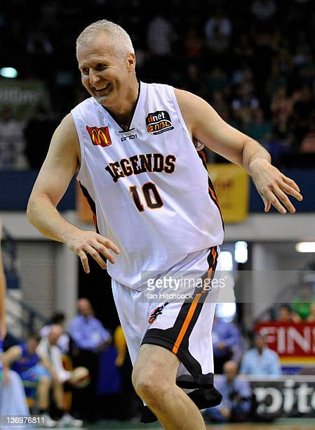 Andrew Gaze of the NBL Legends shares a laugh during a legends match before the start of the round 15 NBL match between the Townsville Crocodiles and...