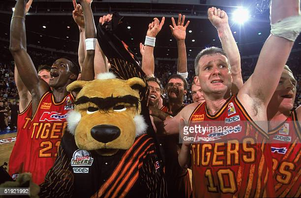Andrew Gaze of the Tigers celebrates with the team after winning the 1997 NBL Final between the Melbourne Tigers and South East Melbourne Magic...