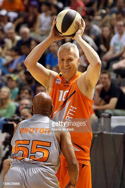 Andrew Gaze prepares to ball the ball during the Legends and Celebrities game that formed the half time entertainment during the NBL AllStar game...