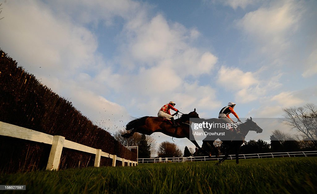 Andrew Glassonbury riding Sulpius (L) on their way to winning The BetVictor Cheltenham Festival Antepost Pioneers Novices' Handicap Steeple Chase during the last meeting to be held after 114 years of racing at Folkestone racecourse on December 18, 2012 in Folkestone, England.