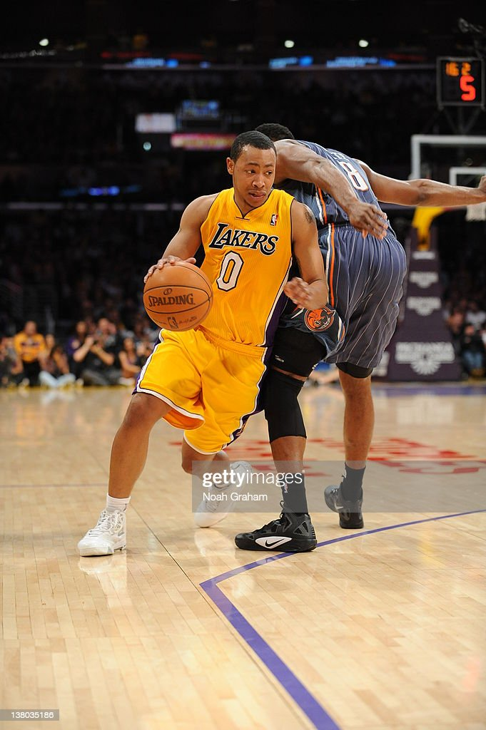 Andrew Goudelock #0 of the Los Angeles Lakers drives around defense during the game between the Los Angeles Lakers and the Charlotte Bobcats at Staples Center on January 31, 2012 in Los Angeles, California.