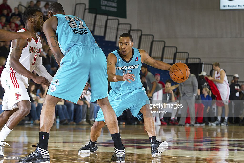 Andrew Goudelock #15 of the Sioux Falls Skyforce drives around a pick set by teammate Jarvis Varnado #32 against the Maine Red Claws on December 2, 2012 at the Portland Expo in Portland, Maine.