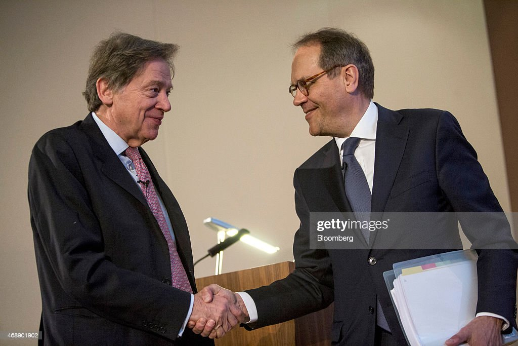 Andrew Gould, chairman of BG Group Plc, left, shakes hands with <a gi-track='captionPersonalityLinkClicked' href=/galleries/search?phrase=Jorma+Ollila&family=editorial&specificpeople=619838 ng-click='$event.stopPropagation()'>Jorma Ollila</a>, chairman of Royal Dutch Shell Plc, during a news conference at the London Stock Exchange in London, U.K., on Wednesday, April 8, 2015. Shell agreed to buy BG Group for about 47 billion pounds ($70 billion) in cash and shares, the oil and gas industry's biggest deal in at least a decade. Photographer: David Levenson/Bloomberg via Getty Images
