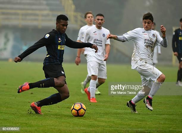 Andrew Gravillon of FC Internazionale Primavera competes for the ball with Pietro Guatieri of Novara Calcio during the Primavera Tim juvenile match...