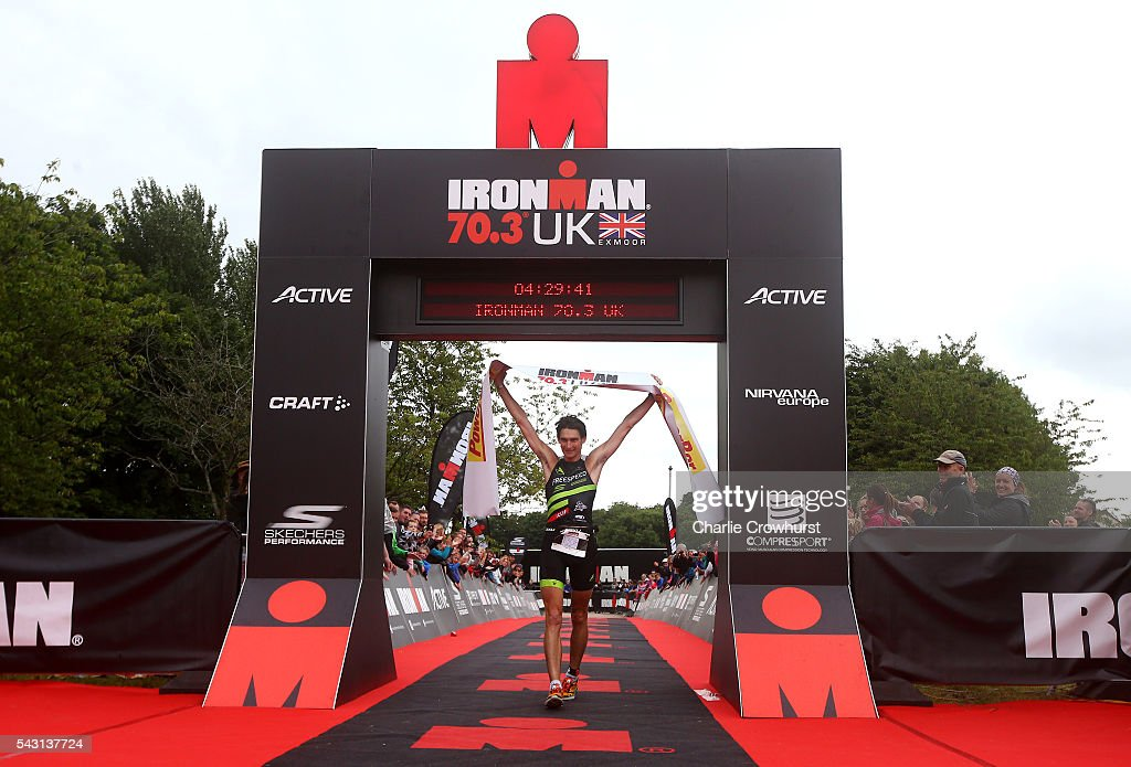 Andrew Greenleaf celebrates winning the men's race during the Ironman 70.3 UK at Exmoor National Park on June 26, 2016 in Somerset, England.