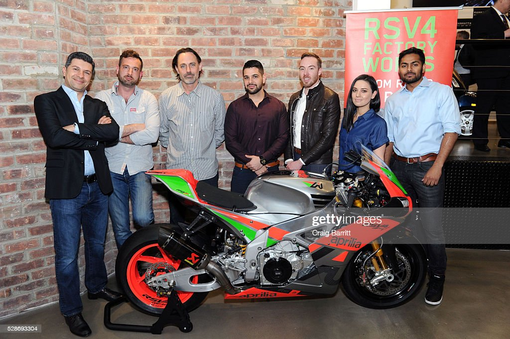 Andrew Hadjiminas (L), President Vespa Manhattan attends the New York debut of the Aprilia RSV4 World SBK RF Misano & Moto Guzzi MGX-21 Flying Fortress at Vespa Manhattan Flagship on May 6, 2016 in New York City.