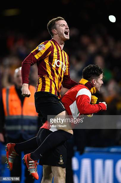 Andrew Halliday of Bradford City celebrates with a teammate following his team's 42 victory during the FA Cup Fourth Round match between Chelsea and...