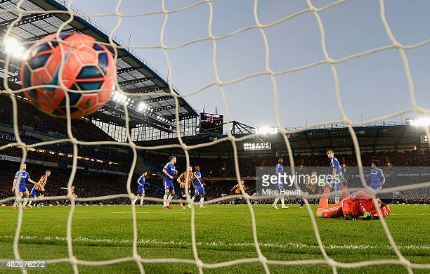 Andrew Halliday of Bradford City scores his team's third goal past goalkeeper Petr Cech of Chelsea during the FA Cup Fourth Round match between...