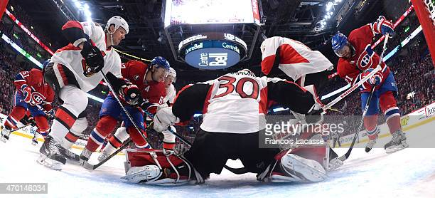 Andrew Hammond of Ottawa Senators defend the goal against Max Pacioretty and Devante SmithPelly of the Montreal Canadiens in Game Two of the Eastern...