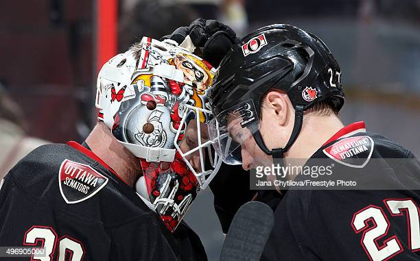 Andrew Hammond of the Ottawa Senators celebrates their win against the Vancouver Canucks with team mate Curtis Lazar during an NHL game at Canadian...