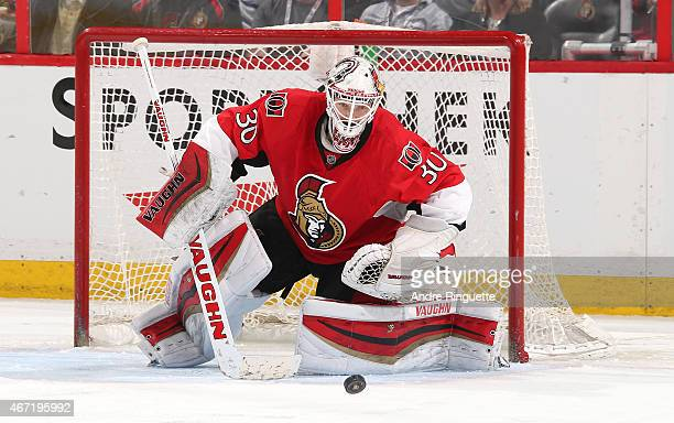 Andrew Hammond of the Ottawa Senators controls a rebound against the Toronto Maple Leafs at Canadian Tire Centre on March 21 2015 in Ottawa Ontario...