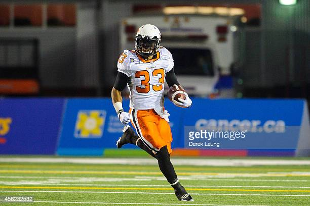 Andrew Harris of the BC Lions runs against the Calgary Stampeders during a CFL game at McMahon Stadium on September 27 2014 in Calgary Alberta Canada