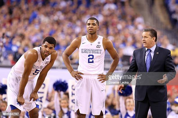 Andrew Harrison Aaron Harrison and head coach John Calipari of the Kentucky Wildcats look on in the first half against the Wisconsin Badgers during...