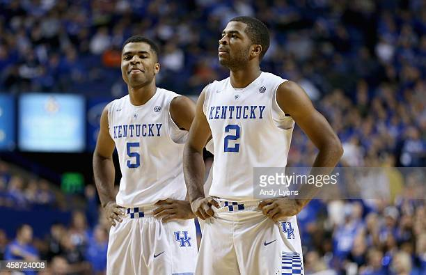 Andrew Harrison and Aaron Harrison of the Kentucky Wildcats watch the action during the game against the Georgetown College Tigers at Rupp Arena on...