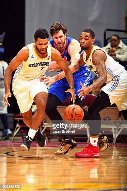 Andrew Harrison and Joel Wright of the Iowa Energy go after a loose ball against Jordan Bachynski of the Westchester Knicks in an NBA DLeague game on...