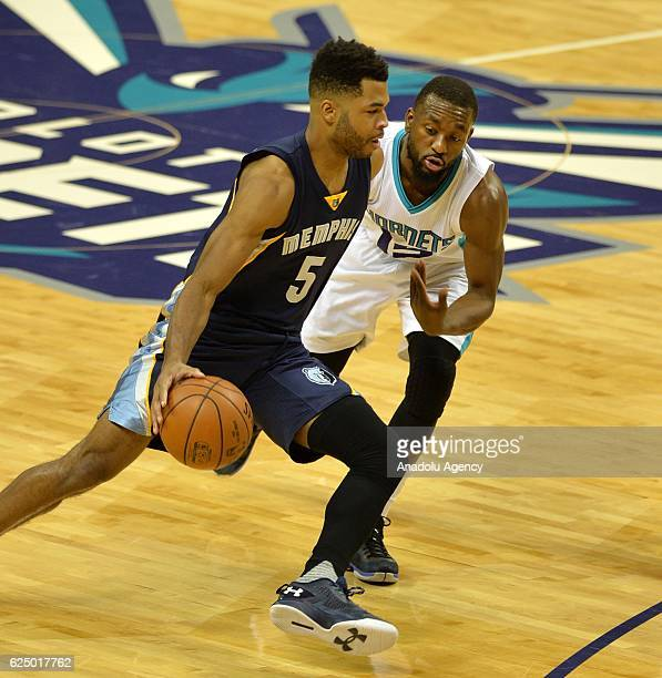 Andrew Harrison of Memphis Grizzlies passes Kemba Walker of Charlotte Hornets during the NBA match between Memphis Grizzlies vs Charlotte Hornets at...
