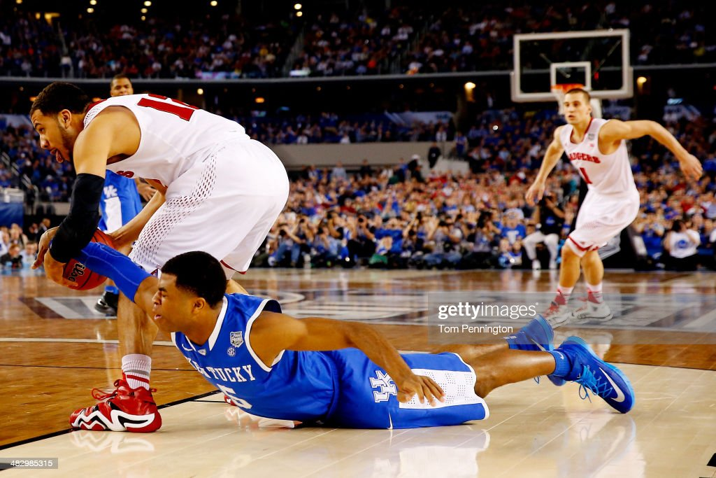 Andrew Harrison #5 of the Kentucky Wildcats defends against <a gi-track='captionPersonalityLinkClicked' href=/galleries/search?phrase=Traevon+Jackson&family=editorial&specificpeople=9984213 ng-click='$event.stopPropagation()'>Traevon Jackson</a> #12 of the Wisconsin Badgers during the NCAA Men's Final Four Semifinal at AT&T Stadium on April 5, 2014 in Arlington, Texas.