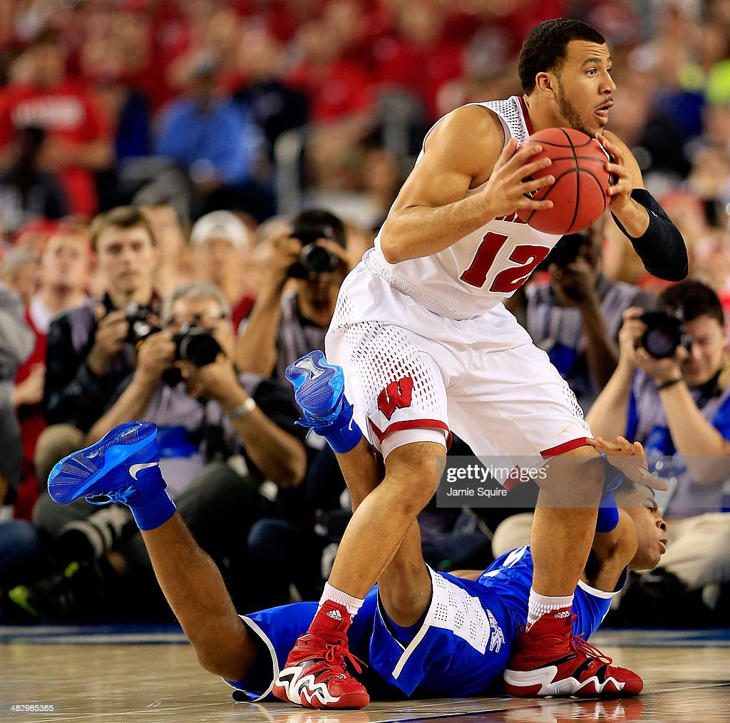 Andrew Harrison of the Kentucky Wildcats defends against Traevon Jackson of the Wisconsin Badgers during the NCAA Men's Final Four Semifinal at ATT...