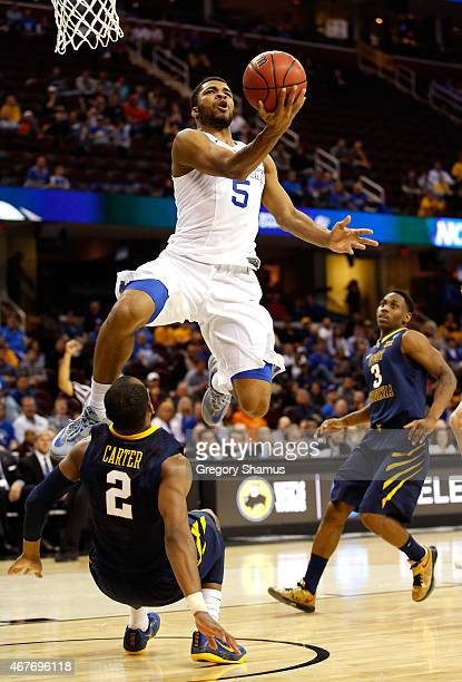 Andrew Harrison of the Kentucky Wildcats drives to the basket against Jevon Carter of the West Virginia Mountaineers in the second half during the...