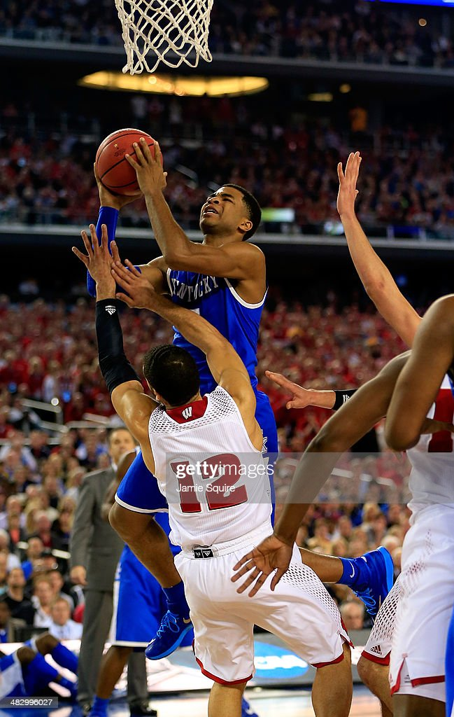 Andrew Harrison of the Kentucky Wildcats goes to the basket as Traevon Jackson of the Wisconsin Badgers defends during the NCAA Men's Final Four...