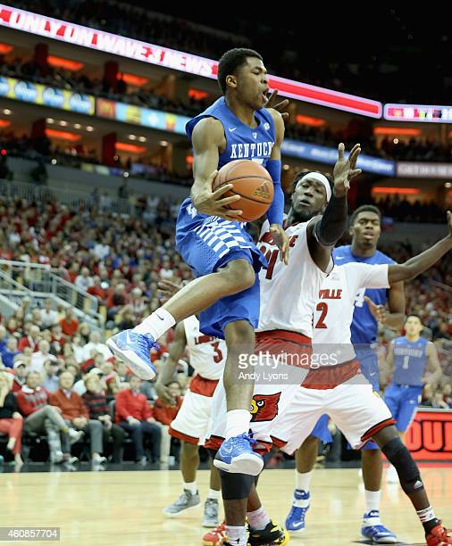 Andrew Harrison of the Kentucky Wildcats passes the ball during the game against the Louisville Cardinals at KFC YUM Center on December 27 2014 in...