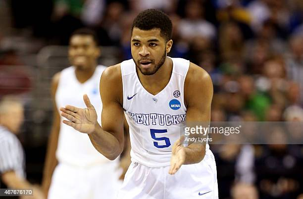 Andrew Harrison of the Kentucky Wildcats reacts after a play in the first half against the West Virginia Mountaineers during the Midwest Regional...