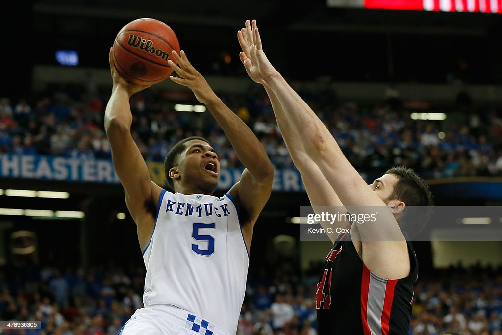 Andrew Harrison of the Kentucky Wildcats takes a shot over Nemanja Djurisic of the Georgia Bulldogs during the semifinals of the SEC Men's Basketball...