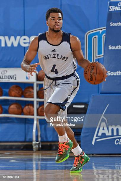 Andrew Harrison of the Memphis Grizzlies dribbles the ball up court against the Orlando MagicBlue during the Orlando Summer League on July 7 2015 at...