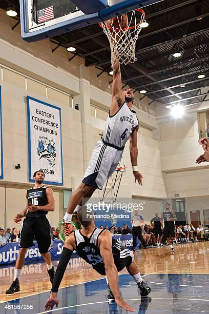 Andrew Harrison of the Memphis Grizzlies dunks the ball up against the Orlando MagicBlue during the Orlando Summer League on July 7 2015 at Amway...