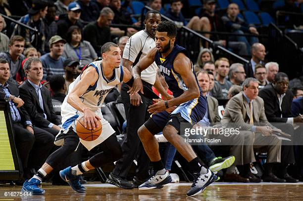 Andrew Harrison of the Memphis Grizzlies guards against Zach LaVine of the Minnesota Timberwolves during the preseason game on October 19 2016 at...