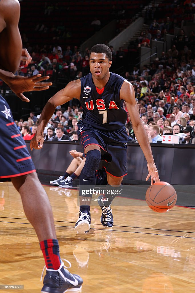 Andrew Harrison #7 of the USA Junior Select Team drives against the World Select Team during the 2013 Nike Hoop Summit game on April 20, 2013 at the Rose Garden Arena in Portland, Oregon.