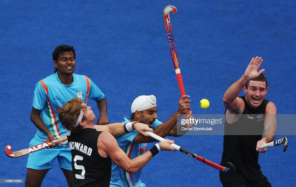 Andrew Hayward and Phillip Burrows of New Zealand challenge Danish Mujtaba and Gurwinder Singh Chandi of India for the ball during the Men's preliminary Hockey match on Day 5 of the London 2012 Olympic Games at Riverbank Arena on August 1, 2012 in London, England.