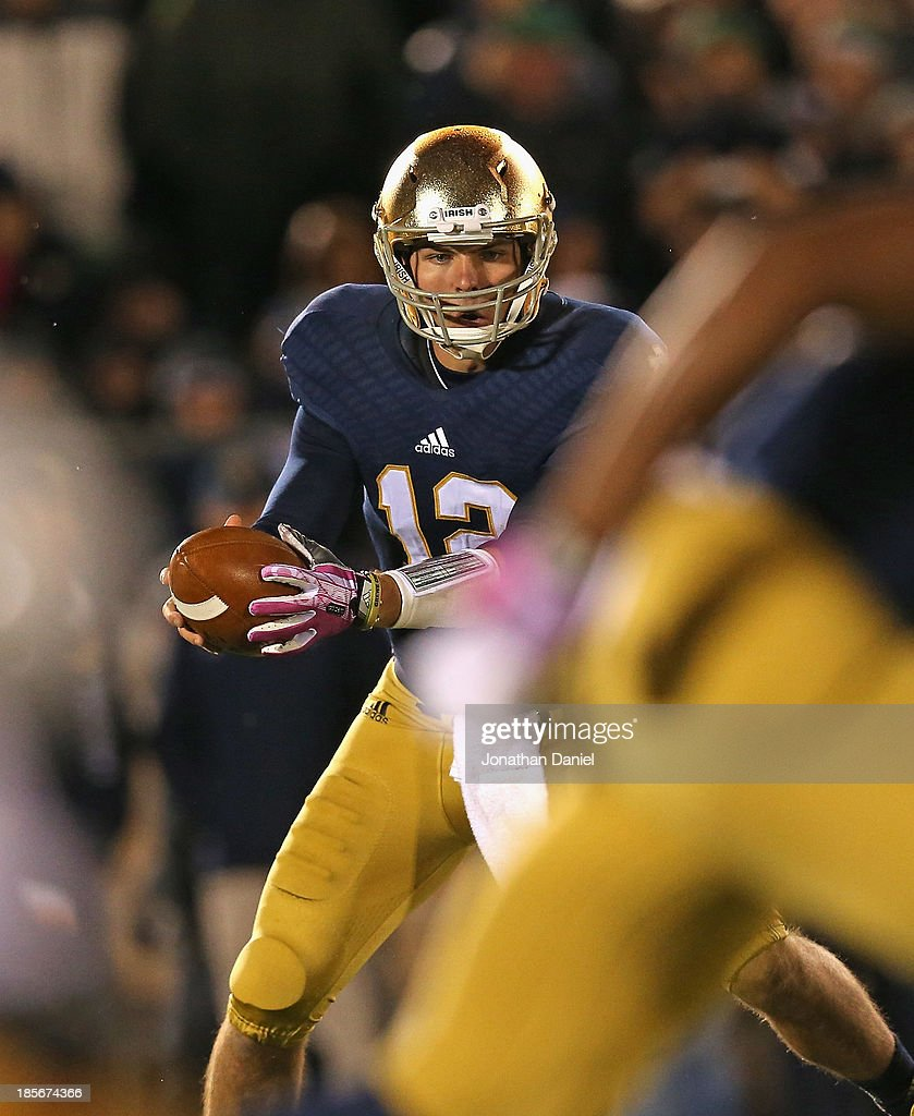 Andrew Hendrix #12 of the Notre Dame Fighting Irish waits to hand off against the University of Southern California Trojans at Notre Dame Stadium on October 19, 2013 in South Bend, Indiana. Notre Dame defeated USC
