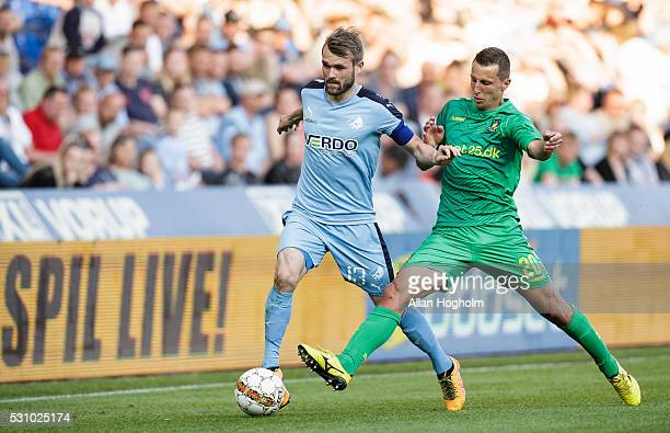 Andrew Hjulsager of Brondby IF and Mandla Masango of Randers FC compete for the ball during the Danish Alka Superliga match between Randers FC and...