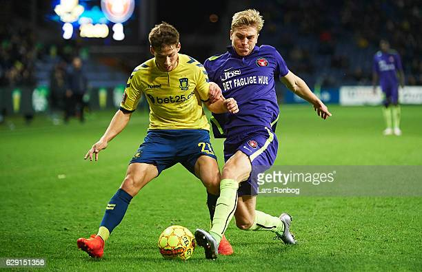 Andrew Hjulsager of Brondby IF and Rasmus Nissen of FC Midtjylland compete for the ball during the Danish Alka Superliga match between Brondby IF and...