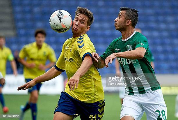Andrew Hjulsager of Brondby IF and Veselin Penev of PFC Beroe Stara Zagora compete for the ball during the UEFA Europa League Qualification match...