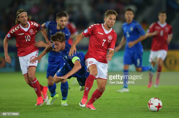 Andrew Hjulsager of Denmark and Daniele Rugani of Italy compete for the ball during the UEFA European Under21 Championship Group C match between...