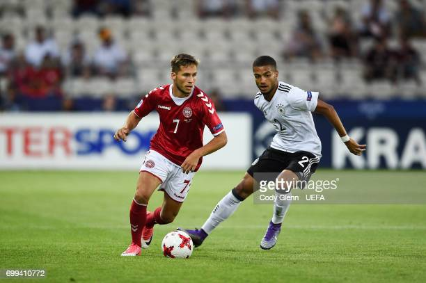 Andrew Hjulsager of Denmark and Jeremy Toljan of Germany during their UEFA European Under21 Championship 2017 match on June 21 2017 in Krakow Poland